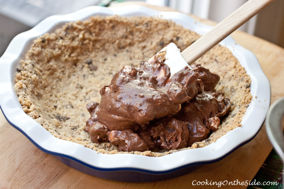 Filling the shortbread crust with rocky road brownie pudding