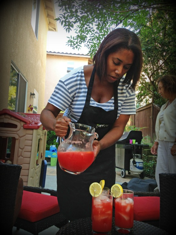 The pouring of the lemonade